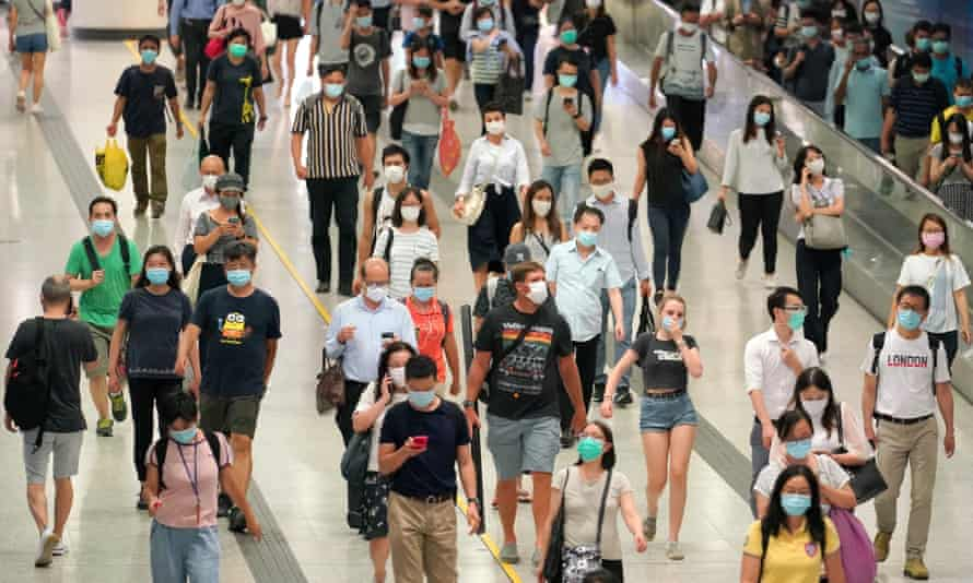 people wearing face coverings in Hong Kong.