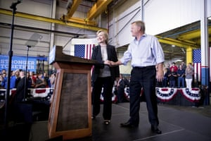 Hillary Clinton is welcomed to the stage by Futuramic Tool & Engineering president Mark Jurcak.
