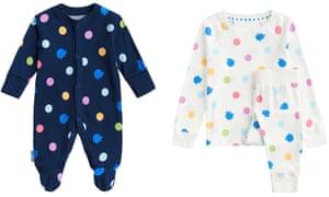 A blue spotty onesie and white spotty pyjamas
