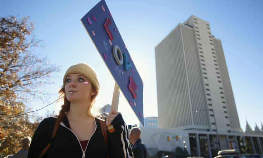 In November, a member of the LDS church holds a sign as she resigns her membership to the church following the controversial anti-gay policy.