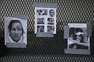 Printed photographs of allegedly injured protesters taped to a fence near a courthouse in Portland, US