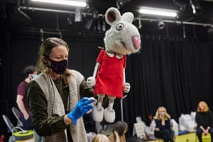 Director Samantha Lane (who also adapted the book for the production) wipes down the mouse puppet in rehearsal. Strict Covid protocols are in place, including bubbles for the main cast members