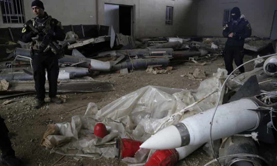 Iraqi special forces troops inspect missiles found in a warehouse in eastern Mosul, Iraq, on Saturday.