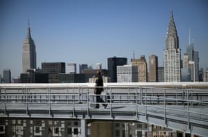 A security guard patrols the roof of the secretariat building.
