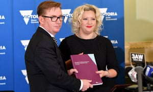 Former Australian Medical Association head Brian Owen hands over a report to Victorian health minister Jill Hennessy after the Ministerial Advisory Panel on Voluntary Assisted Dying released its final findings.