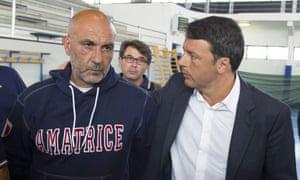 Italian premier Matteo Renzi talks to the mayor of Amatrice Sergio Pirozzi on a visit to the earthquake-hit town.