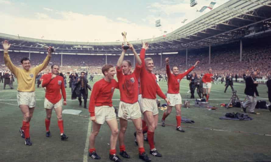 Bobby Charlton holds the Jules Rimet trophy after England's World Cup victory over West Germany at Wembley Stadium, 30 July 1966.