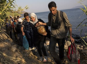 Migrants from Syria and Afghanistan arrive on the Greek island of Lesbos.