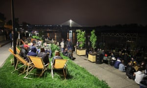 People are seen enjoying the evening by the Vistula river boulevard in Warsaw, Poland on May 14, 2021. On Friday night at 12 bars and restaurants with open spaces will be allowed to operate agains after nearly 7 months of closure. Poland Reopens Bars And Midnight, Warsaw - 14 May 2021