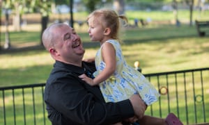 Chris Carlson of Nashua, New Hampshire with his daughter, Summer Carlson at Boston Commons in Boston, Massachusetts.