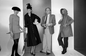 Cardin stands with models during the presentation of a retrospective haute couture collection from 1950 to 1980, in Paris in 1981