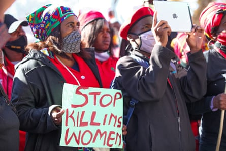 People gather outside the Roodepoort magistrates court in June where a man appeared via a video link on a premeditated murder charge after the death of Tshegofatso Pule, a 28-year-old pregnant woman.