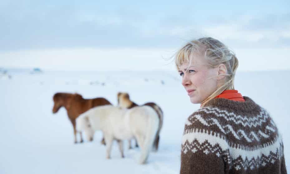 Heida in the snowy fields with ponies