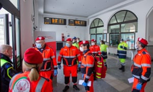 Workers from the Italian Emergency Health Service wear high-grade protective medical face masks outside the central train station in Potenza, southern Italy, 08 March 2020.