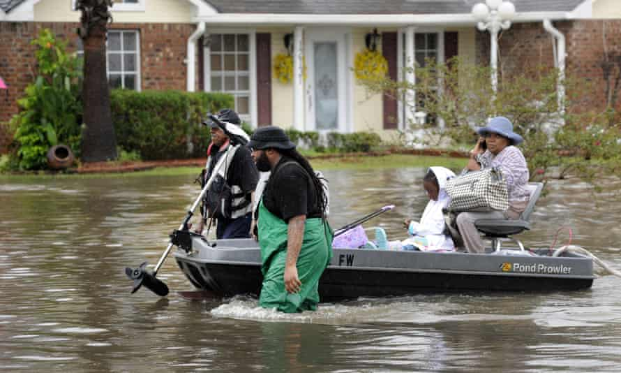 Close to two feet of rain fell over a 48-hour period in parts of southern Louisiana, causing residents to scramble to safety from flooded homes and cars.