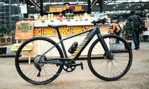 canyon roadlite on ebike parked by market stall