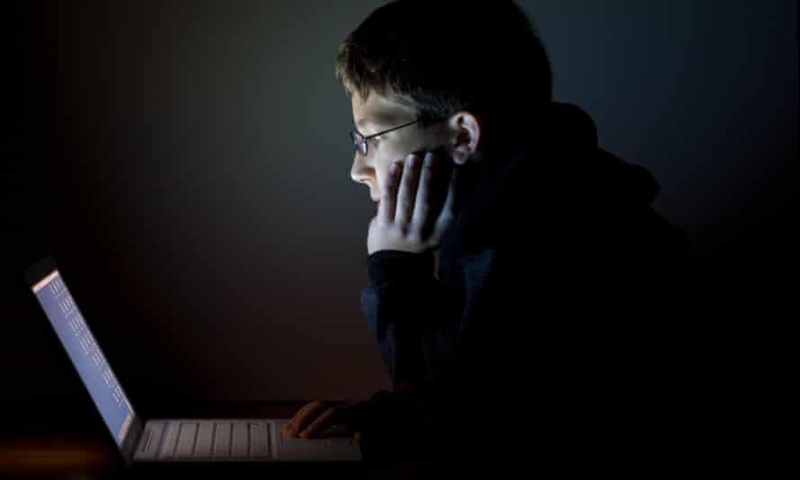 Teen Boy In the Dark with Laptop