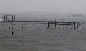The Emerald Isle bridge is seen in the distance past the flooded docks in Bogue Sound on 13 September.