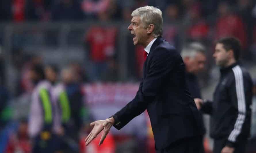 Arsène Wenger tries to get a point over to Arsenal's players during the 5-1 Champions League defeat at Bayern Munich.