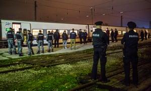 Bosnian police at Bihac train station await a train full of migrants arriving from Sarajevo
