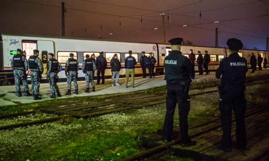 Bosnian police at Bihac train station await a train full of migrants arriving from Sarajevo