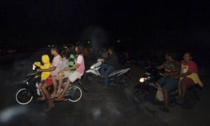 Residents in Padang fled to higher ground after the magnitude-7.8 earthquake struck off the west coast of Sumatra