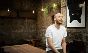 Ben Chapman perched on the edge of a table at Smoking Goat
