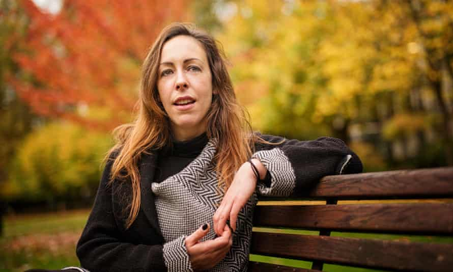University lecturer and researcher Xanthe Whittaker sitting on a bench