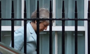 Theresa May arrives at the back entrance of 10 Downing Street in London