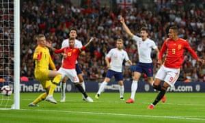 England's players call for offside as Spain's Rodrigo scores.