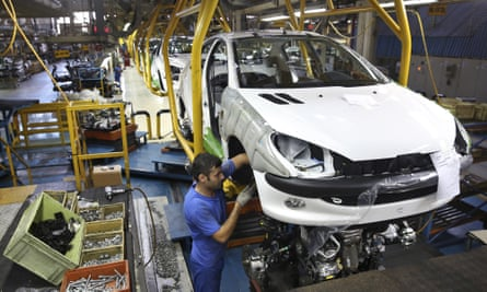 An Iranian worker assembles a Peugeot 206 at the state-run Iran Khodro plant near Tehran