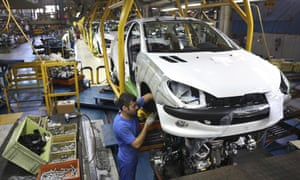 A worker assembling a Peugeot 206 at the state-run Iran Khodro plant.