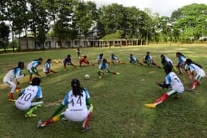 Players from the high school team in Kolsindur, 200km north of Dhaka, stretch during a training session