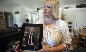 Laurie Holt holds a photograph of her son, Joshua Holt, at her home, in Riverton, Utah on 13 July 2016.
