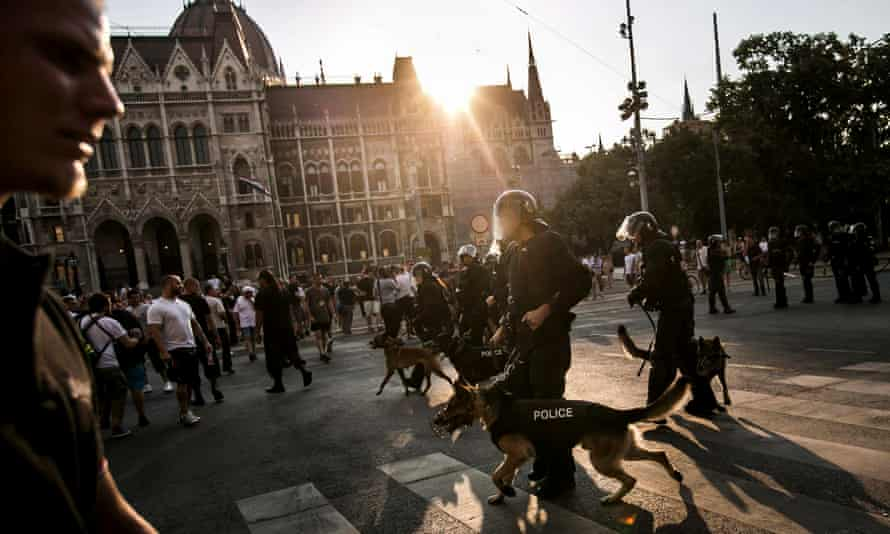 Riot police face rightwing demonstrators protesting against a Pride march in Budapest, Hungary, 2012.