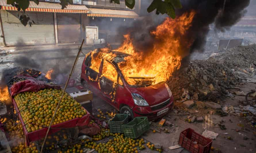 The cars of protesters opposing a new citizenship law are set ablaze in Delhi, India.