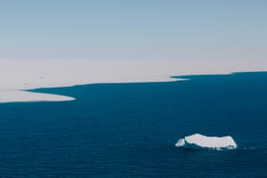 Driven by currents more than winds, an iceberg drifts along the edge of the pack ice