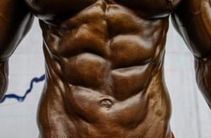 A bodybuilder poses before taking part in the first round of the Dharmashree nationwide bodybuilding championship in Kathmandu, Nepal