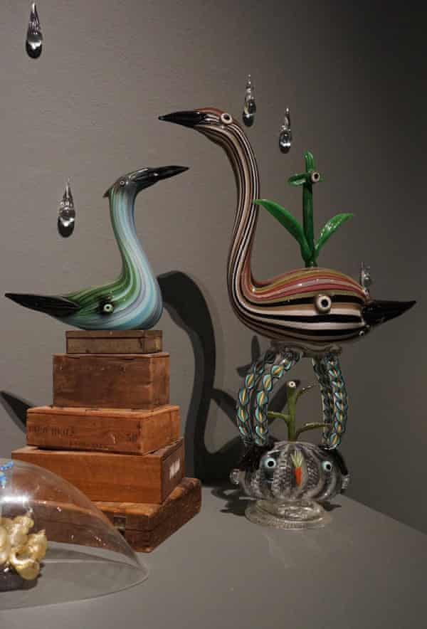 Glass figurines by Tom Moore.