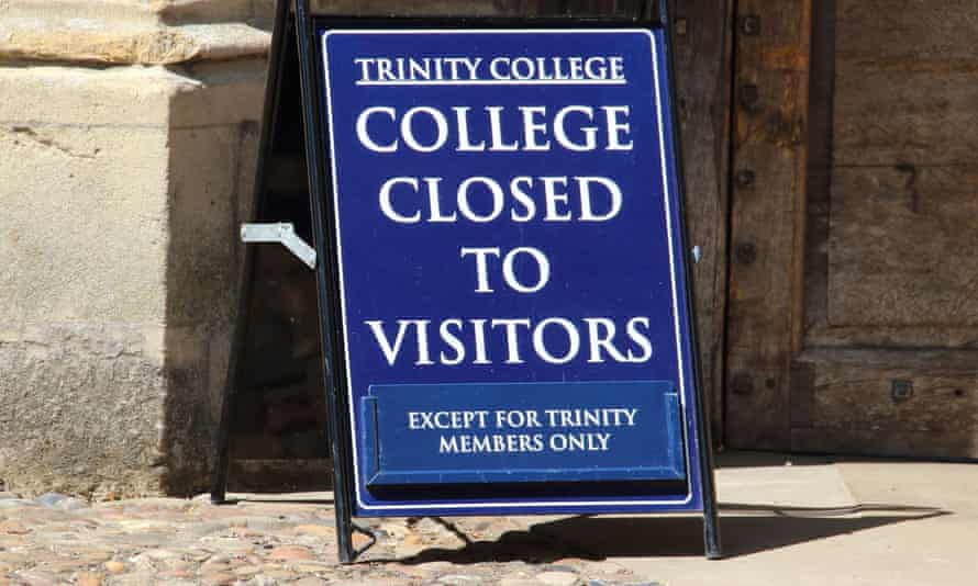 A view of a sign informing the public about the closure of Trinity College, Cambridge