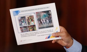 Venezuela's President Nicolas Maduro holds a placard that reads 'Fake pictures presented by Iván Duque at the UN' during a news conference in Caracas, Venezuela, on Monday.