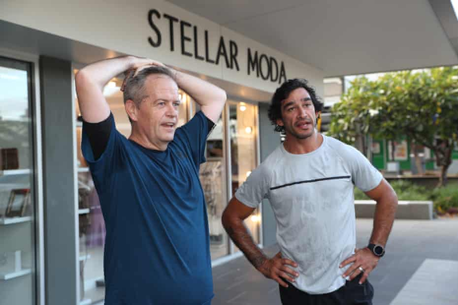 Bill Shorten goes for a run with retired rugby league player Johnathan Thurston in Townsville