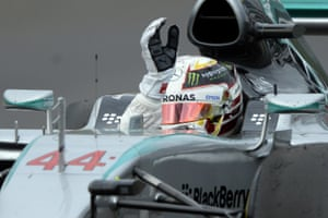 Lewis Hamilton raises his armas his wins the Russian Grand Prix.