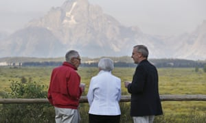 Janet Yellen (centre) chats with Fed colleagues Stanley Fischer (left) and Bill Dudley before her speech at Jackson Hole