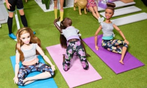 Yoga-practising Barbie dolls