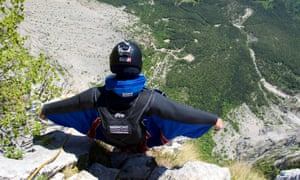 A wingsuit flier about to jump