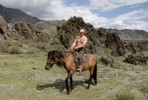 August 2009: Rides a horse during his vacation in Siberia