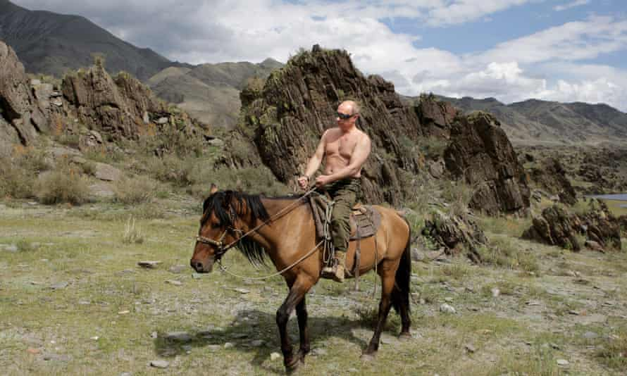 A bare-chested Russian leader Vladimir Putin rides a horse during his vacation outside the town of Kyzyl in Southern Siberia.