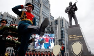 Guards at the unveiling ceremony of a statue of Mikhail Kalashnikov, the Russian inventor of the fabled AK-47 assault rifle, in Moscow