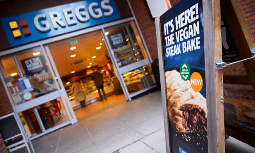 A board announces the launch of the vegan steak bake outside a Manchester branch of Greggs.